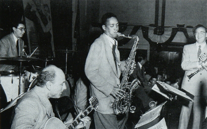 Image of left to right: Mel Zelnick, Billy Bauer, Red Rodney (hidden), Wardell Gray, Stan Hasselgard and Benny Goodman at Westchester County Centre, White Plains, New York, 26 June 1948.