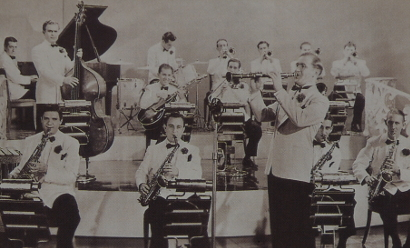 Image of left to right: Jess Stacy, Harry Goodman, Vido Musso, Allen Reuss, Gene Krupa, Hymie Schertzer, Harry James, Murray McEachern, Ziggy Elman, Red Ballard (hidden), Benny Goodman, Gordon Griffin, Art Rollini, Johnny 'Scat' Davis, George Koenig from the film; Hollywood Hotel, July 1937.