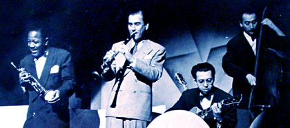 A photograph of Roy Eldridge, Artie Shaw, Barney Kessel and Morris Rayman.